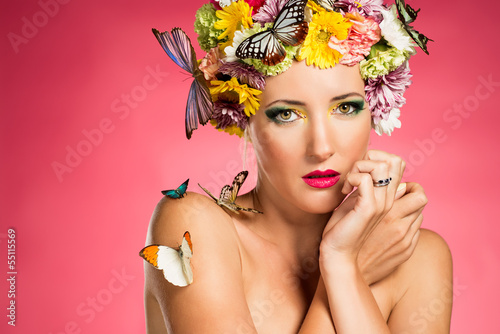 Beautiful woman with flowers and butterflies
