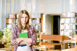 female student in library