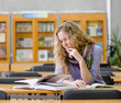 female student in library.