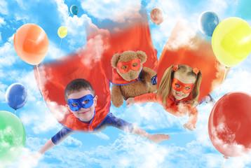 Little Superhero Kids Flying in the Sky