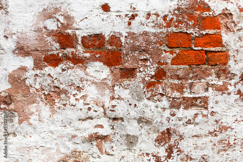 abandoned painted brick wall