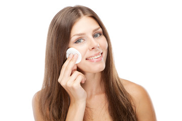 Beautiful young woman with cotton face pads