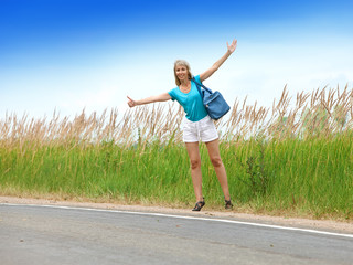 Hitchhiking girl votes on road