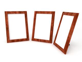 empty wooden frameworks for photos on white