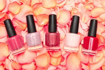 Shiny nail polish on rose petals