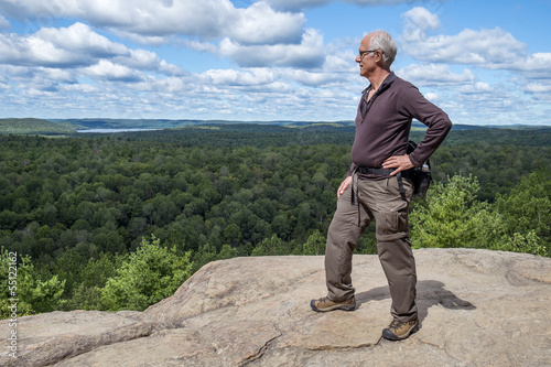 Mature Hiker on Top of a Cliff