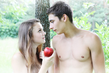 Eve holding an apple