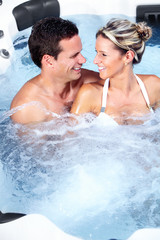 Happy couple in hot tub