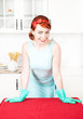 Smiling housewife with rubber gloves
