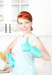 Happy housewife with rubber gloves showing thumbs up