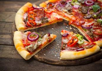 Pizza with ham, mushrooms and cheese