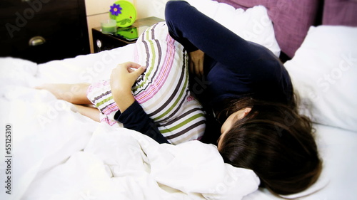 Sic woman in bed with menstrual pain