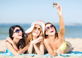 girls taking self photo on the beach