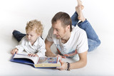 Father is reading to his son isolated on white
