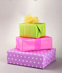 Bright gifts with bows on grey background