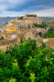 View of beautiful village Ragusa with green tree foreground