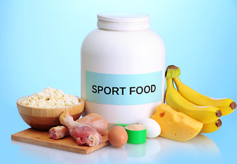jar of protein powder and food with protein, on blue background