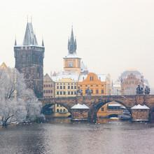 snow Charles bridge in Prague