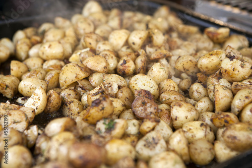potatoes fried in oil in a frying pan with dill
