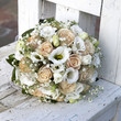 beauty wedding bouquet of roses laying at white chair