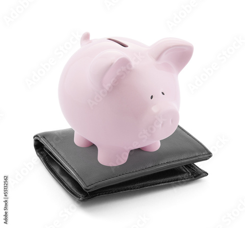 Piggy bank with black leather wallet on white