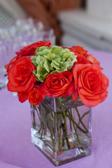 "red rose ""Grand"" in the transparent  glass vase"