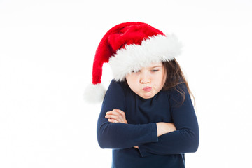 Portrait of a little pouting Christmas girl