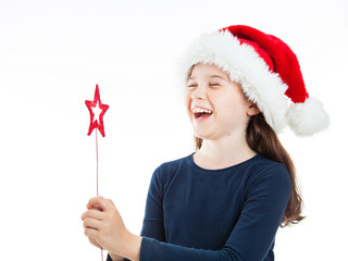 Portrait of a cute little Christmas girl laughing out loud