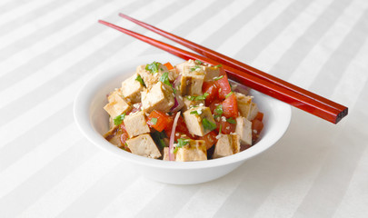 Grilled tofu tossed together with tomatoes, onions, and cilantro