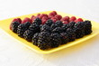 blackberries and raspberries on a platter