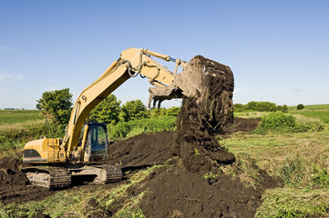 Excavator Moving Dirt