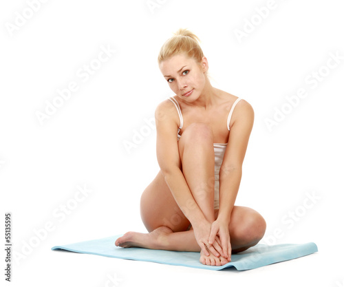 A young sportive girl sitting on the floor