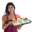 Traditional Indian woman baking cupcakes