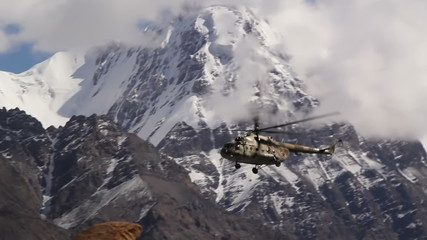 Helicopter sits in the mountains