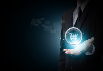 Shopping cart icon in business hand