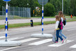 Girls crossing the street on the way to school