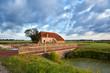 charming farmhouse and blue sky