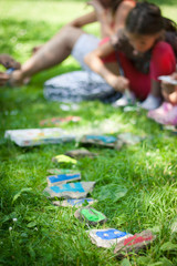 Kids learning the alphabet outdoors on a sunny day