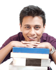 Young Man Smiling with Chin on Books