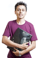 Young Man Smiling Carrying a Laptop