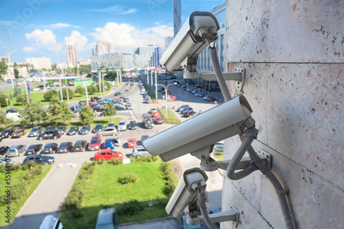 Video surveillance cameras on wall looking at street area - 55144907