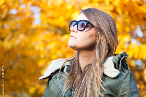 Woman relaxing outdoor during autumn
