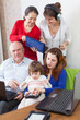 Happy  family uses  various electronic devices in home