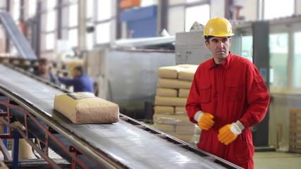 Worker controls sacks of sugar in Warehouse