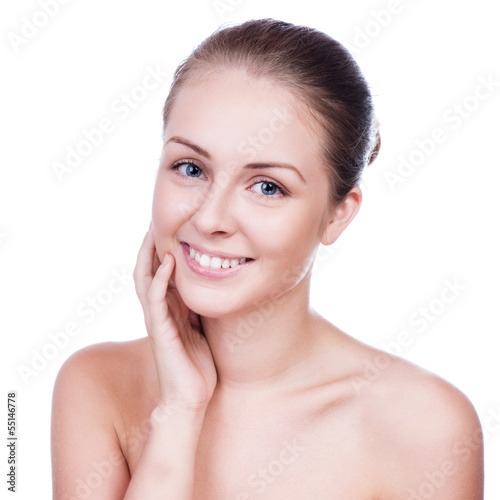 Beautiful woman cares for the skin face