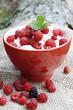 Raspberries with cream,selective focus