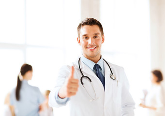 doctor with stethoscope showing thumbs up