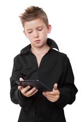 Boy holding black tablet.