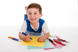 Young Boy Drawing on Colored Paper.