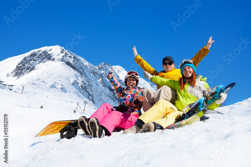Three students in snow with snowboards